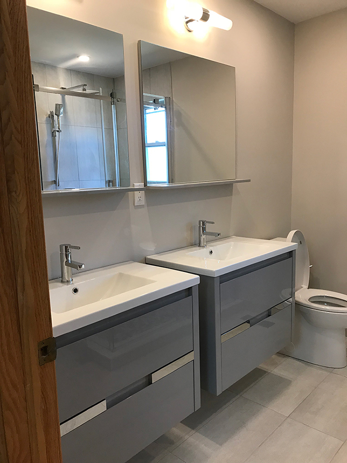 dual sinks with two mirrors in bathroom